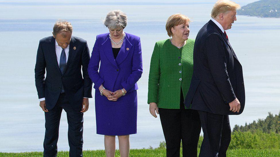 Donald Tusk, Theresa May, Angela Merkel and Donald Trump at the 2018 G7 summit in Canada