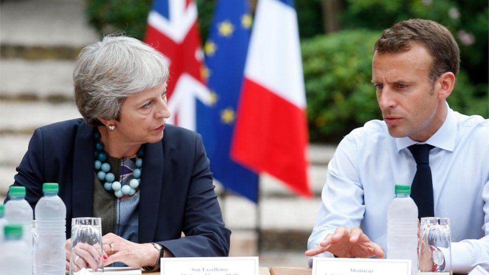 Theresa May and Emmanuel Macron at the French president's summer retreat