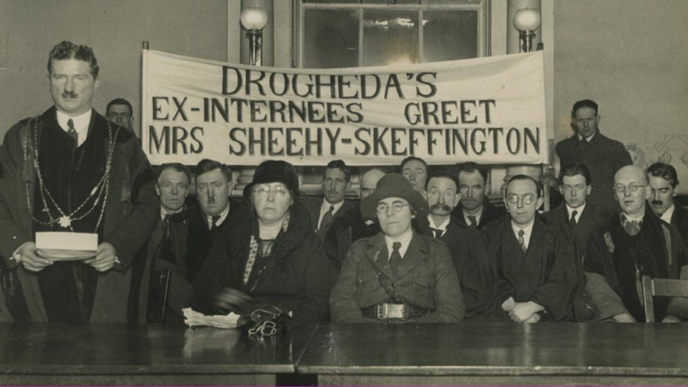 Eithne Coyle (seated centre right) in Cumann na mBan uniform at a reception in Dundalk in 1933