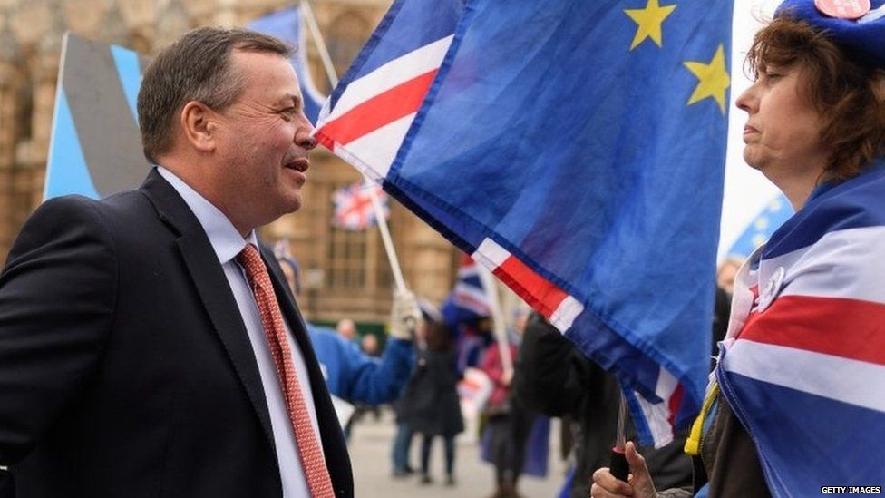 Arron Banks and a anti-Brexit demonstrator in Westminster