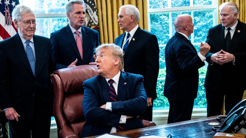 President Donald Trump speaks with Senate Majority Leader Mitch McConnell (left)