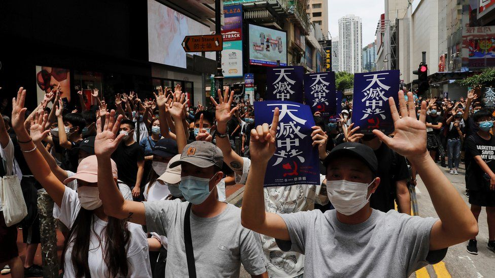 Anti-government protesters march against Beijing's plans to impose national security legislation in Hong Kong, 24 May 2020