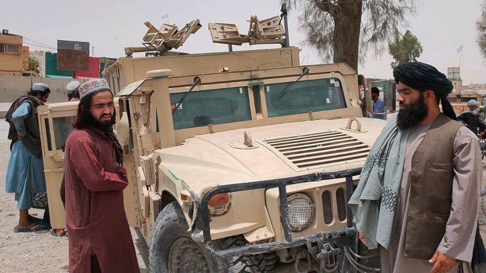 Taliban with a captured vehicle