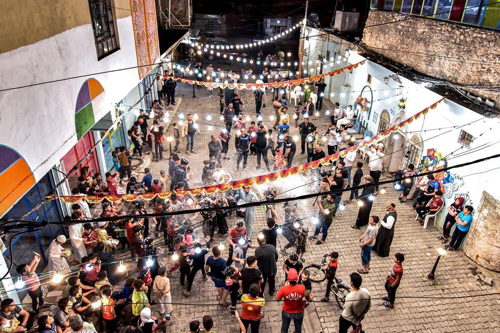 People enjoy a street celebration during Ramadan