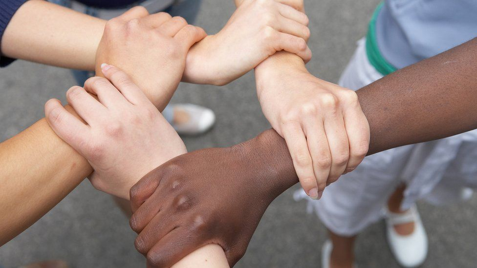 Children linking arms