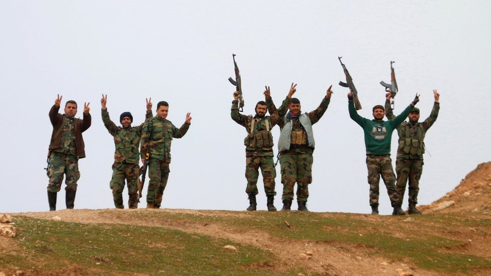 Syrian government forces celebrate taking control of village of Kiffin, on northern outskirts of Aleppo. 11 Feb 2016