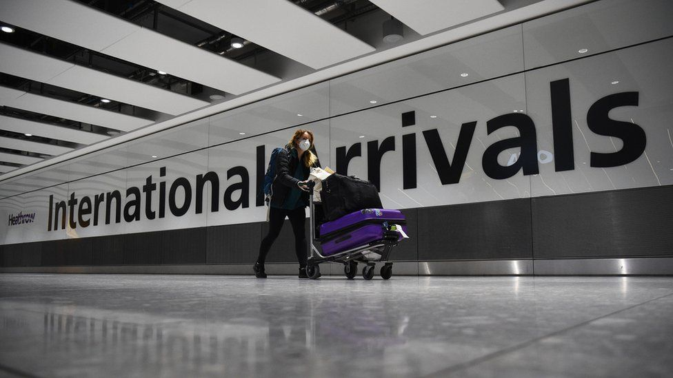 Woman arriving at Heathrow terminal 5