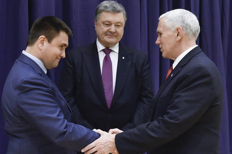 United States Vice President Mike Pence, right, shakes hands with Ukrainian Foreign Minister Pavlo Klimkin, left, as Ukraine's President Petro Poroshenko looks on, centre, during the Munich Security Conference in Munich, Germany, Saturday, Feb. 18, 2017.