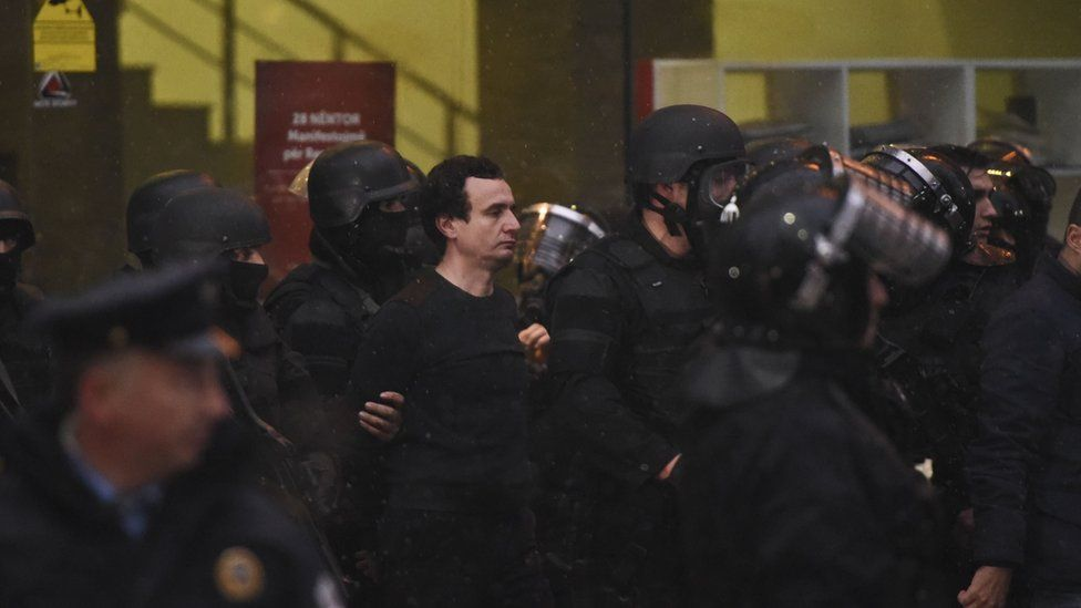 Kosovar policemen detain opposition lawmaker Albin Kurti (C) at the Vetevendosje headquarters