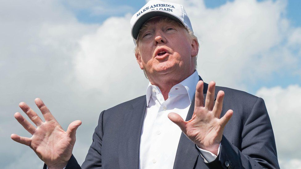 Donald Trump speaks at his golf course in Scotland.
