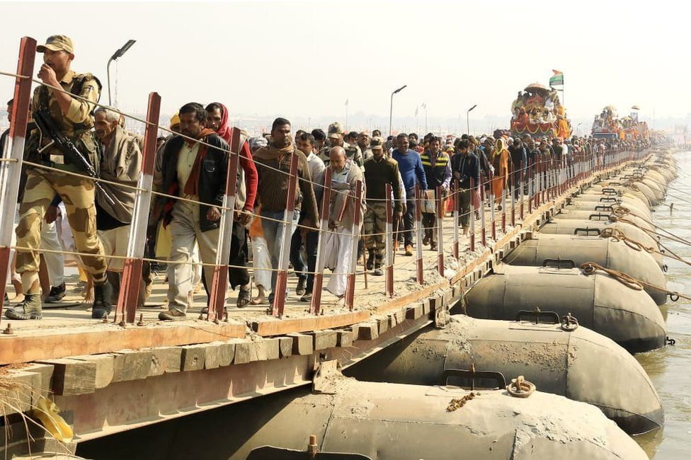 A procession of holy men and devotees at the Kumbh Mela.