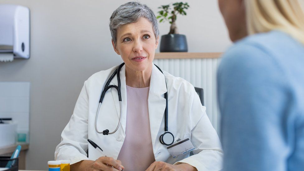 A GP with a patient
