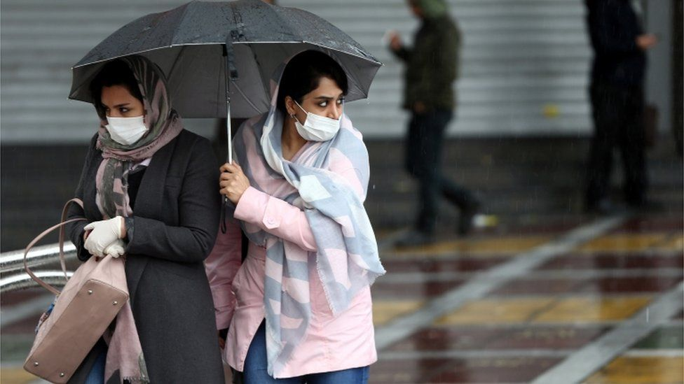 Iranian women in Tehran wear protective masks to prevent contracting coronavirus