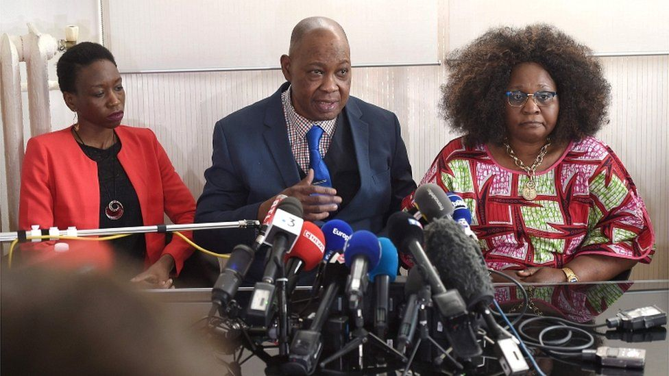 Naomi Musenga's, Louange, her father, Mukole, and her mother, Honorine, speak to journalists on 10 May 2018 in Strasbourg
