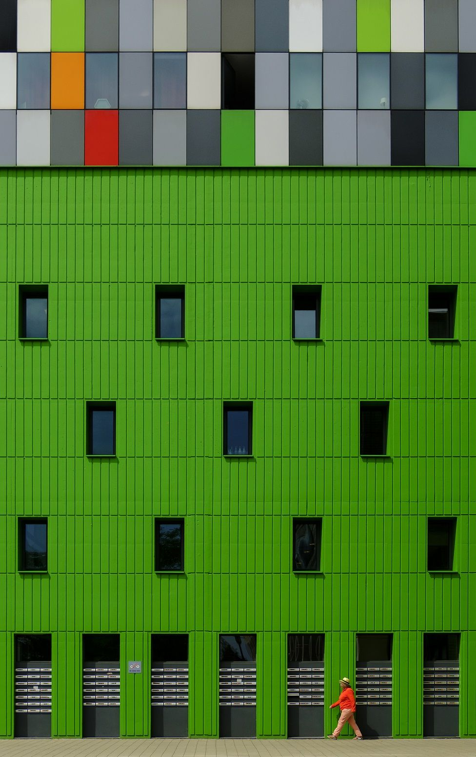 A building with a green exterior wall