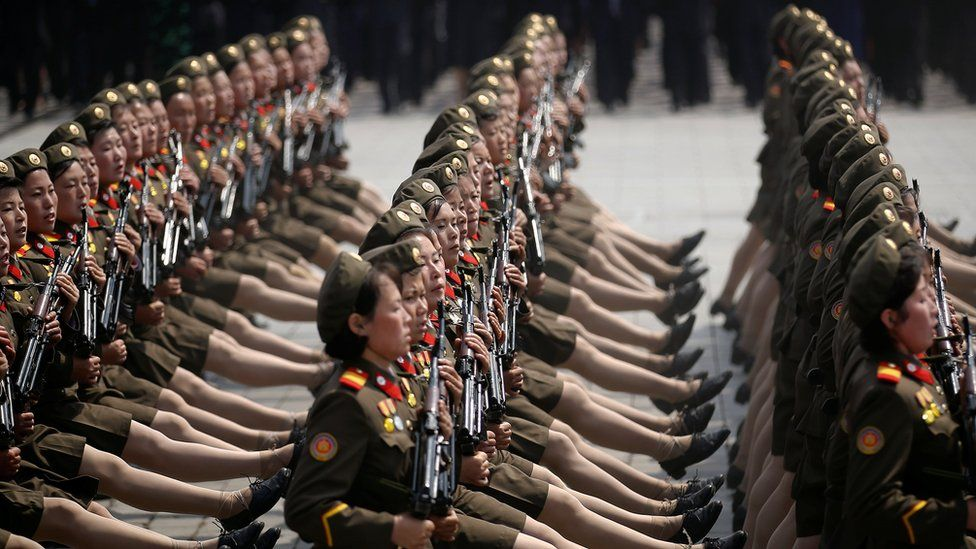 Female soldiers goose-stepping with perfect precision