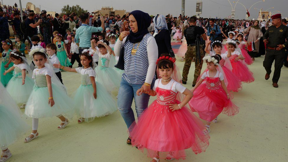 Girls in dresses at the Mosul spring festival
