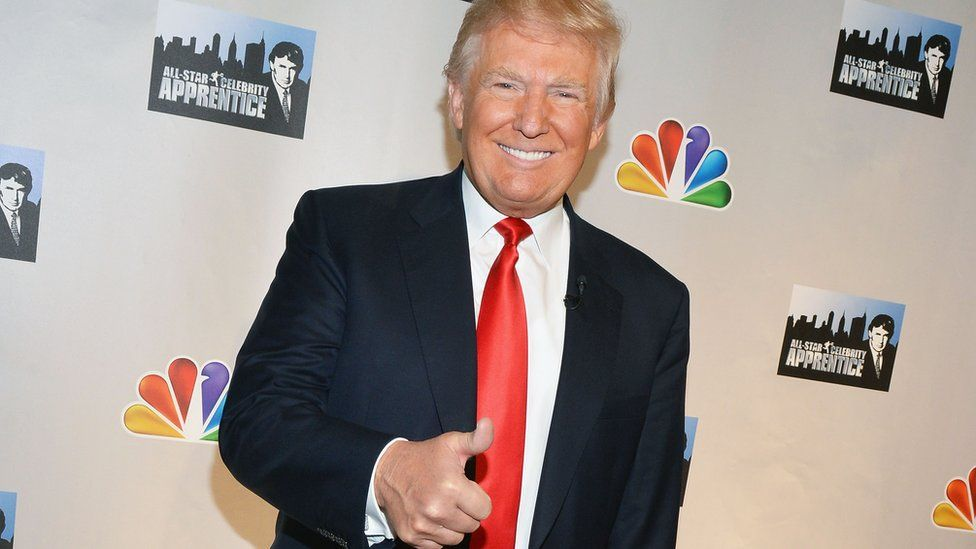 Donald Trump posing as host of The Apprentice