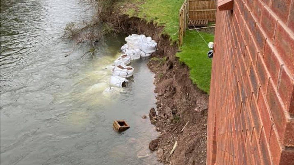 river water against house