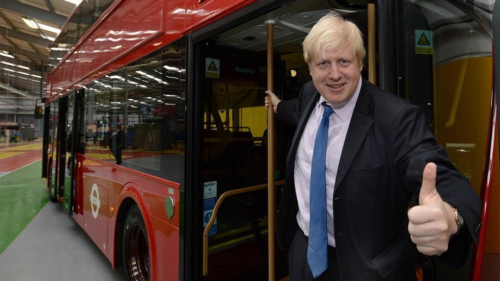 Boris Johnson with a Routemaster 'Boris Bus' at the Wrightbus factory