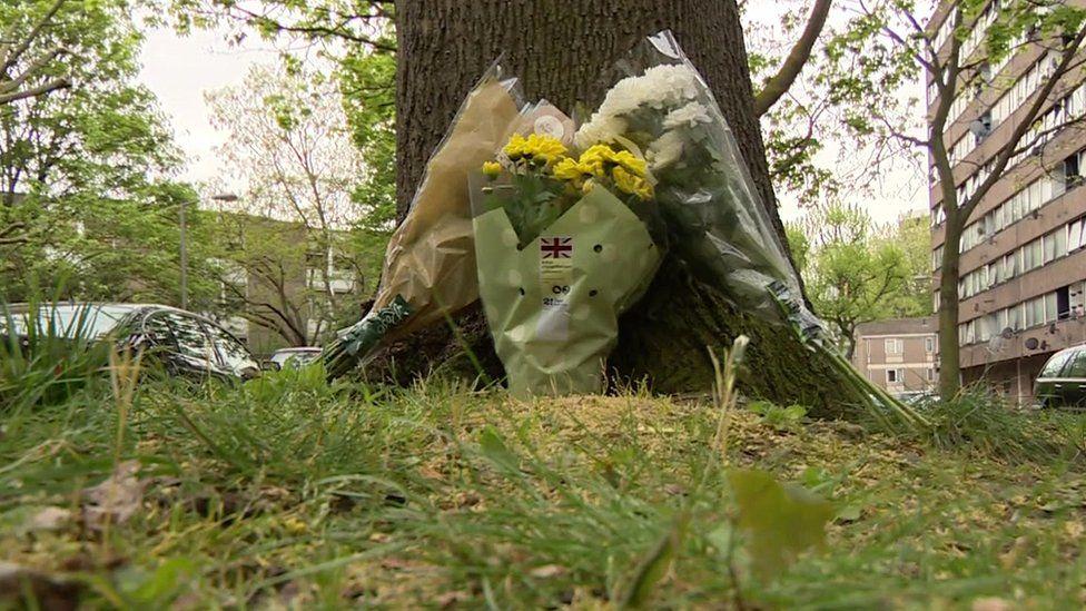 Flowers left next to tree