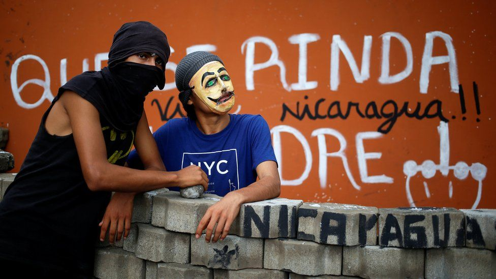 Demonstrators stand at a barricade blocking the entrance of the National Agrarian University (UNA) during a protest against President Daniel Ortega's government