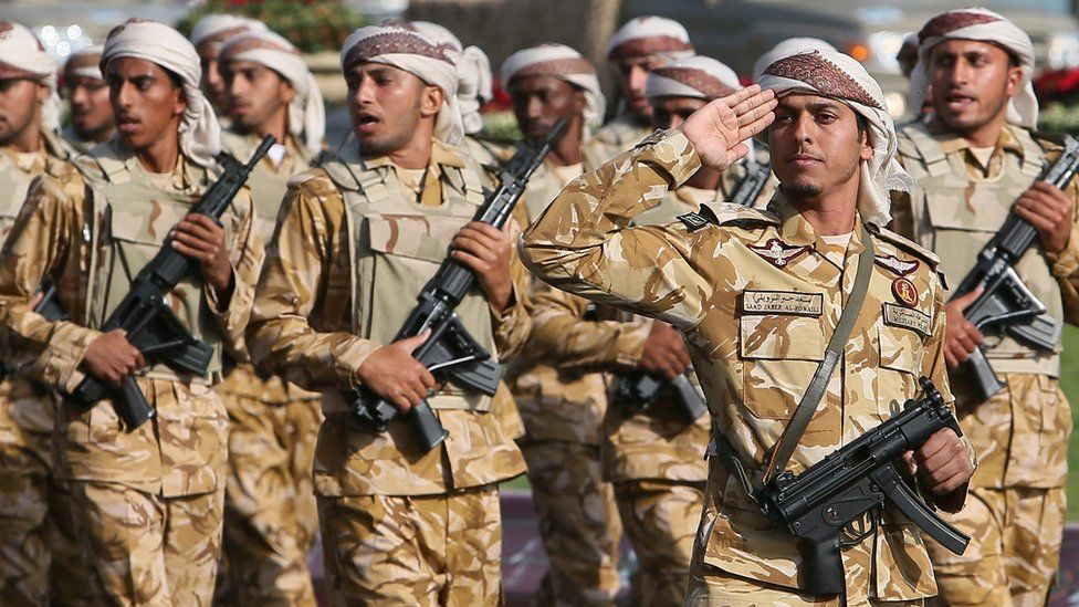 Qatari army forces take part in a military parade during the Gulf emirate's National Day celebrations in Doha 18 December 2013