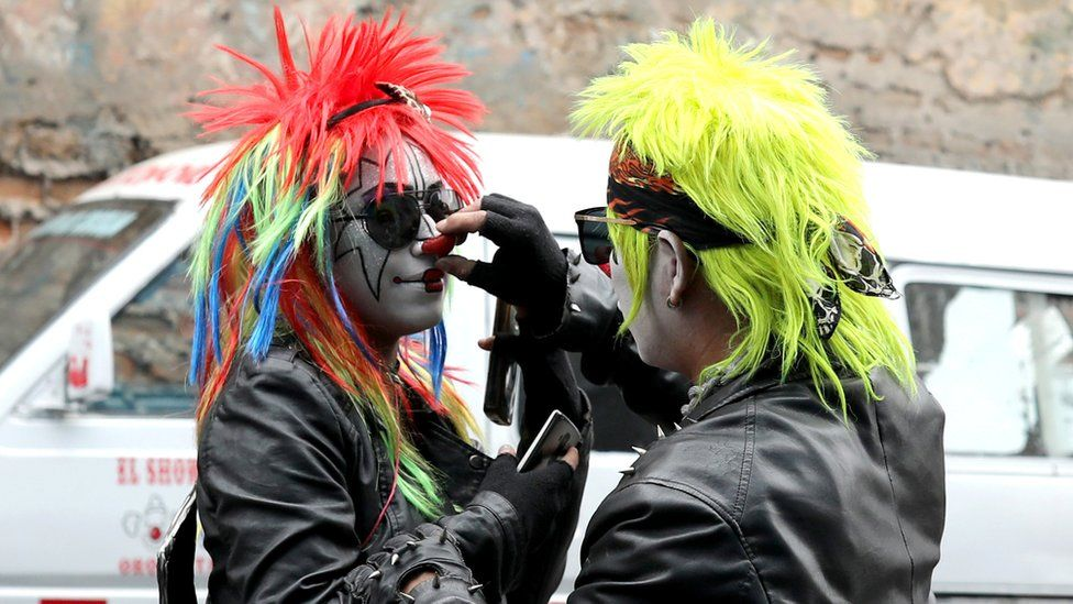 Clowns prepare themselves to take part in a parade during Peru's Clown Day celebrations in Lima, Peru May 25, 2018