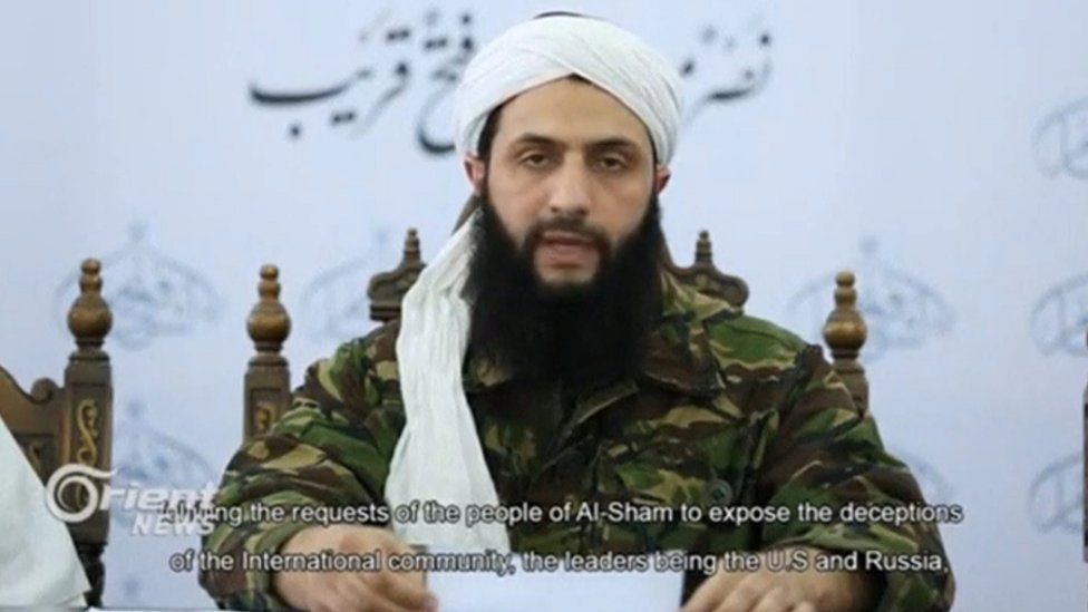 Screengrab from a video, showing Abu Mohammed al-Jawlani, the leader of the Syrian Islamist rebel group Jabhat Fateh al-Sham, formerly known as Nusra Front, delivering a statement