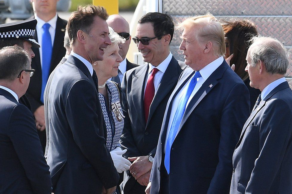 Foreign Secretary Jeremy Hunt greets President Trump on the tarmac at Stansted airport