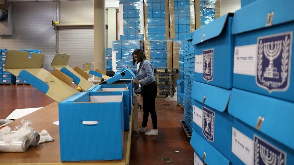 A woman sorts ballot boxes at the Israel Central Election Committee Logistic Centre in Shoham (6 March 2019)