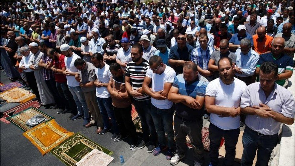 Worshippers pray outside Lions' Gate (14/07/17)