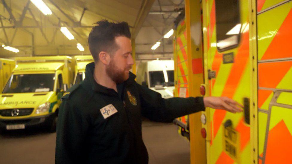 Will Moore closing an ambulance door