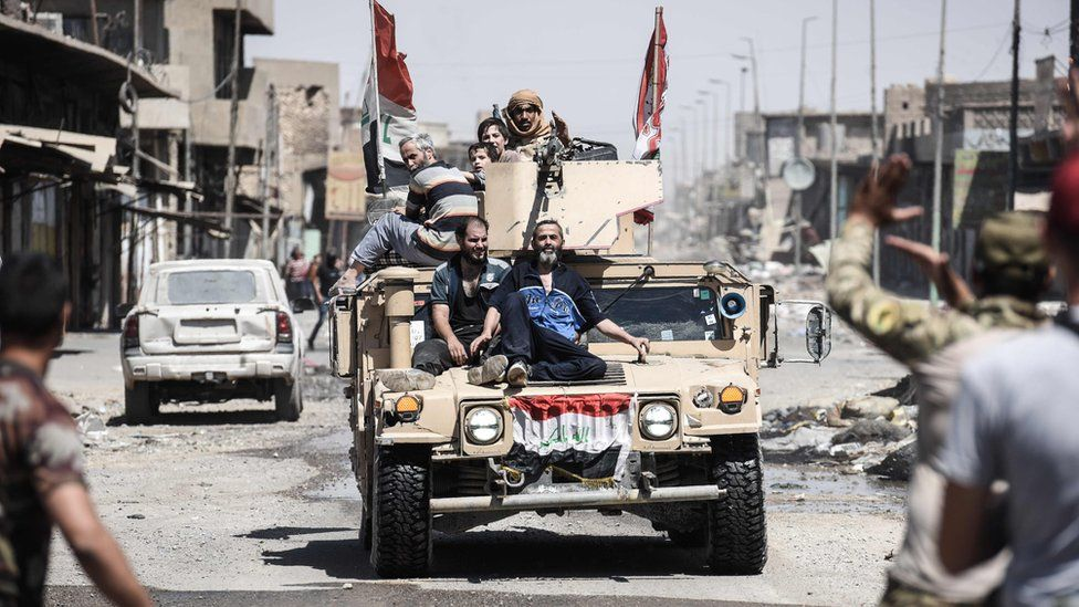 Iraqi citizens fleeing the Old City of Mosul, 23 June 2017