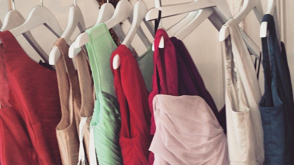 Selection of bridesmaids dresses hanging up