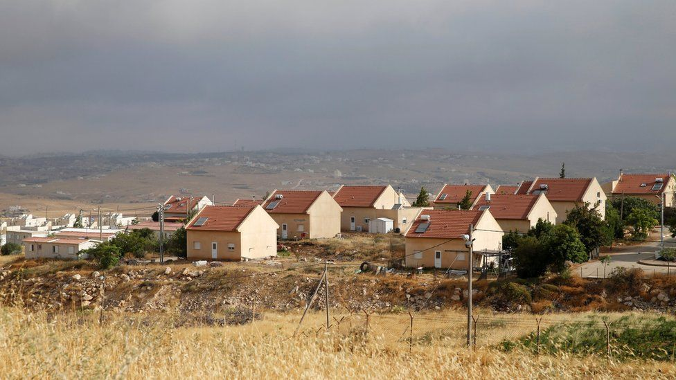 Houses are seen in the West Bank Jewish settlement of Karmel, near Hebron on 24 May
