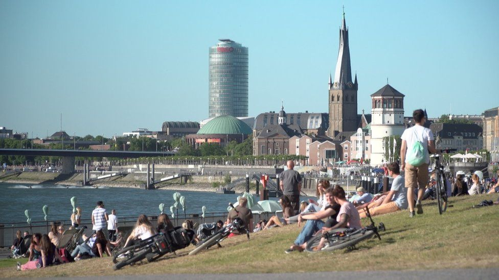 People relaxing on the grass in Germany