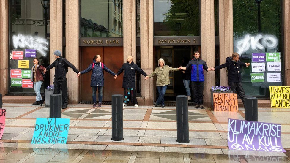 Climate protesters block the entrance to Norway's central bank