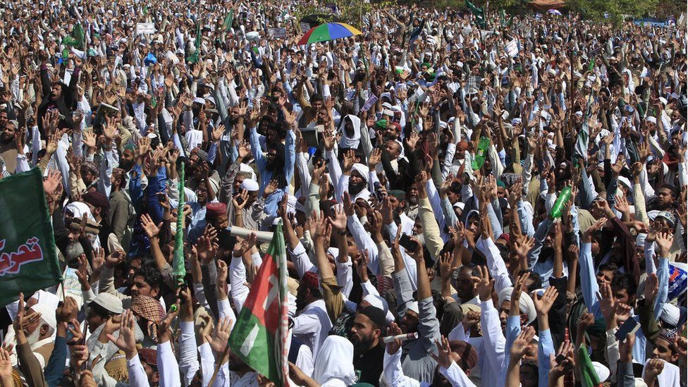 Islamist activists chant slogans over the execution of Mumtaz Qadri, as they gather at Rawalpindi's Liaqat Bagh before marching towards Islamabad.
