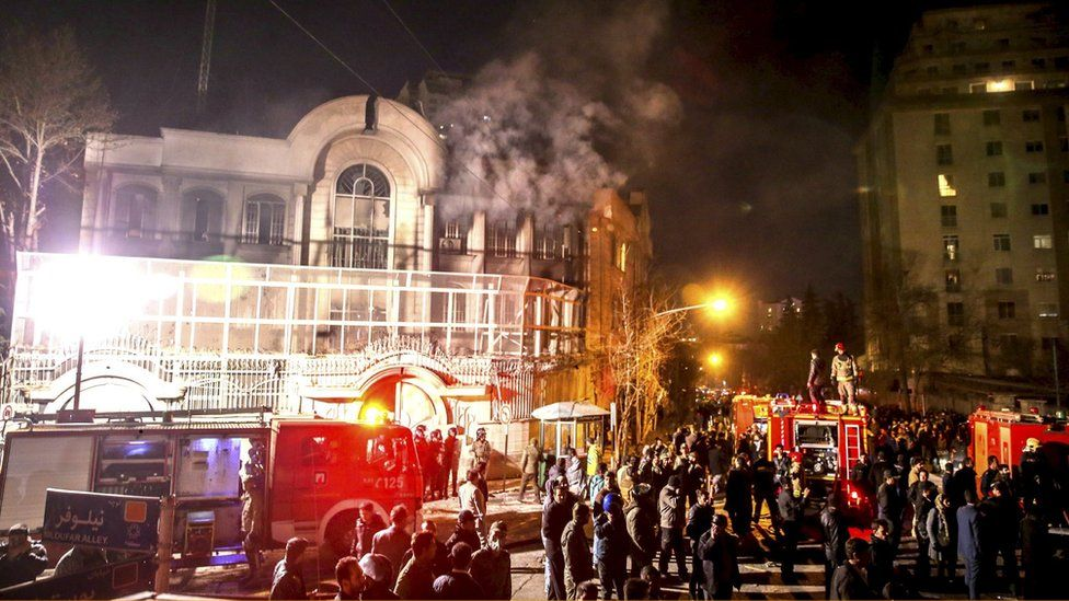Flames rise from Saudi Arabia's embassy during a demonstration in Tehran on 2 January 2016