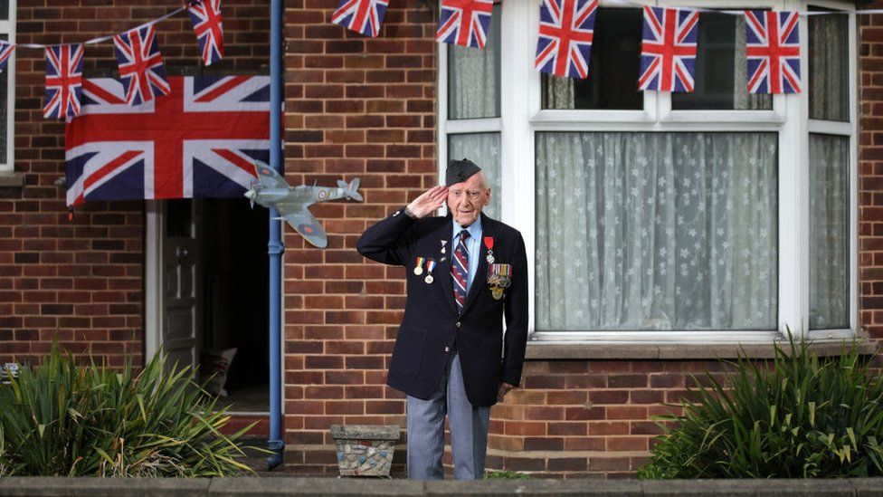 World War Two veteran Bernard Morgan, 96, stood outside his home for the two-minute silence