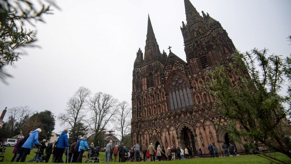 Members of the public queue outside Lichfield Cathedral
