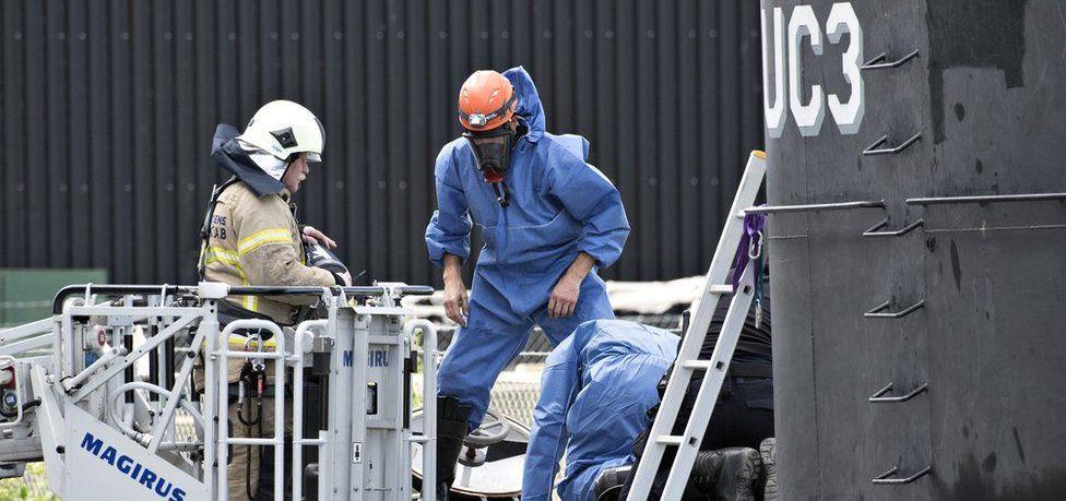 Danish police technicians investigating the recovered privately owned submarine Nautilus UC3 in Copenhagen Harbour