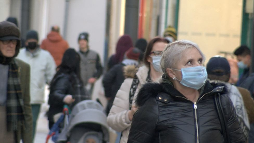 Woman wearing mask on Strand Street