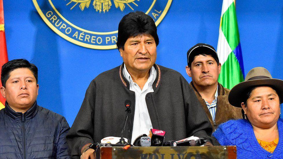 Evo Morales speaking at a podium in November 2019