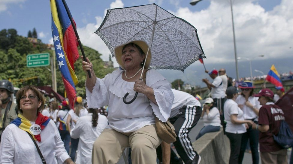 "A woman during a protest demanding a recall referendum against Venezuela""s President Nicolas Maduro in Caracas, Venezuela, Saturday, Oct. 22, 2016."