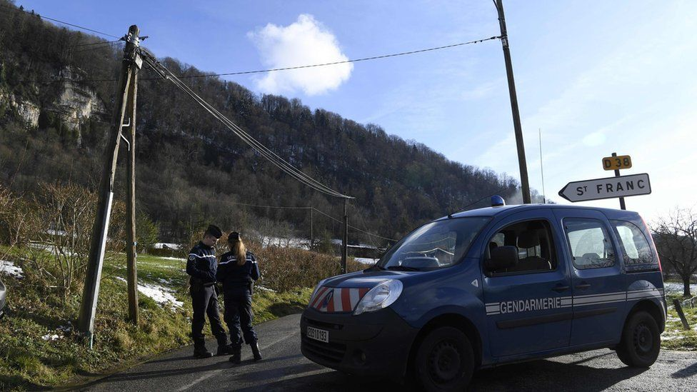 French Gendarmes block the access to Saint-Franc, in the Eastern French region of Savoie on February 14, 2018