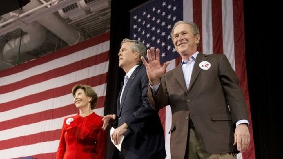 Republican presidential candidate and former Florida Gov Jeb Bush Centre) accompanied by his brother former President George W Bush (right) and George's wife Laura Bush (15 February 2016)
