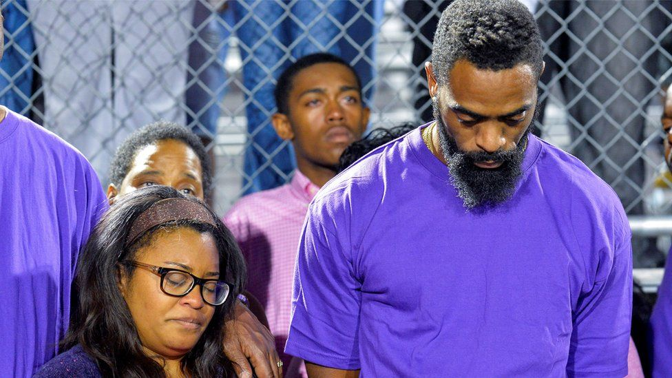 Tyson Gay at a candlelight vigil at Lafayette High School for their daughter Trinity Gay