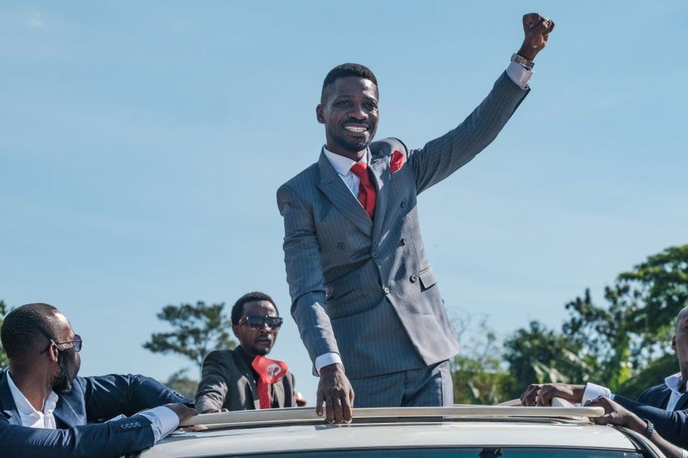 Bobi Wine raising his fist
